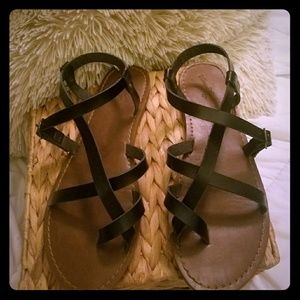 Black strappy sandals. Cute!! Only worn once!